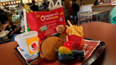 McDonald's to reduce calories in Happy Meals