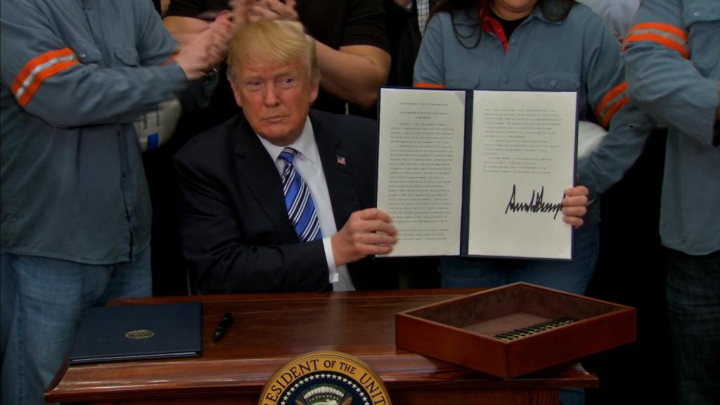 Trump signs new steel, aluminum tariffs