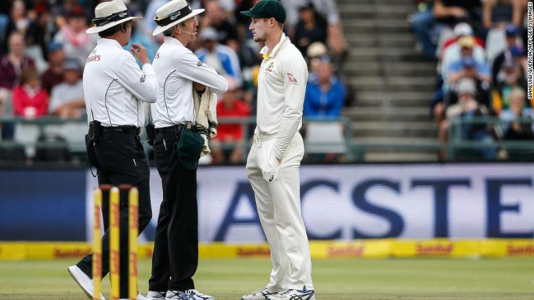 Apologetic Smith breaks down as disgraced trio return to Australia