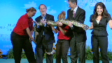 Sea World snake squeezes editor
