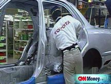 Toyota slashes profits