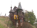 A castle made of car parts and other junkyard finds