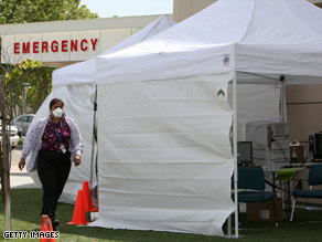 Hospitals like Sutter Delta Medical Center in Antioch, California, set up triage tents to handle overcrowding