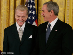 Paul Harvey receives the Medal of Freedom from President George Bush in 2005.