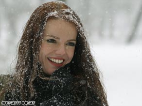 A woman enjoys the snow in Madrid, where the airport suspended flights because of the weather.