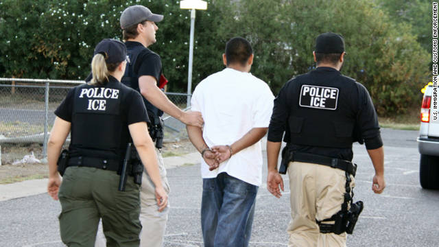 U.S. Immigration and Customs Enforcement agents take part in Operation Cross Check in September 2011.