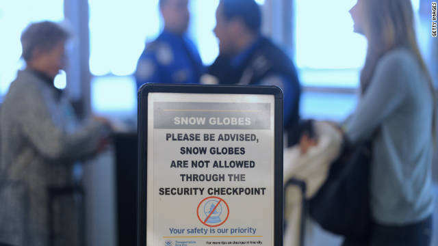Passengers wait to clear security at La Guardia Airport in New York, fully warned about snow globes.