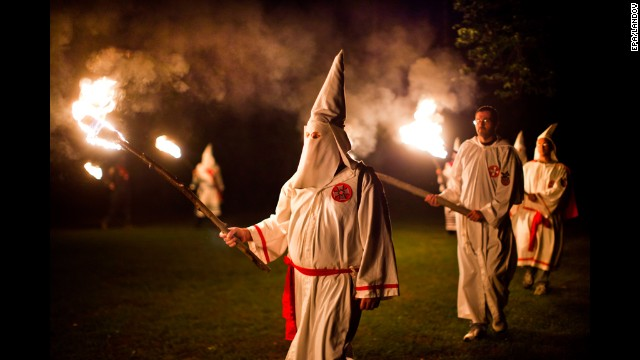 Members of the Knights of the Southern Cross of the Ku Klux Klan, joined by members of other Virginia Klan orders, participate in a cross lighting ceremony on May 28, 2011, near Powhatan, Virginia.