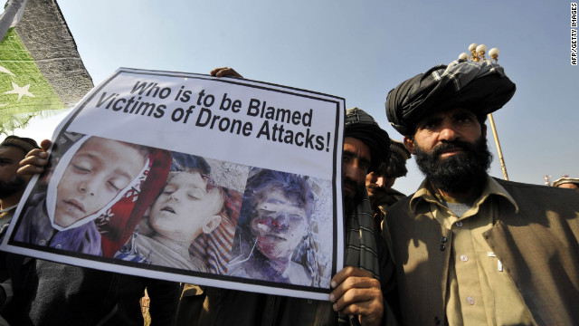 Pakistani tribesmen show a placard of alleged drone strike victims. Peter Bergen says the drone campaign in Pakistan is waning.<br />