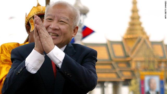 Former Cambodian King Norodom Sihanouk greets well-wishers in front of Phnom Penh's Royal Palace in 2002.