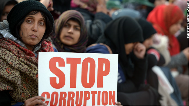 Supporters of Canadian-Pakistani cleric Tahir-ul Qadri hold placards during a protest in Islamabad on January 15, 2013.
