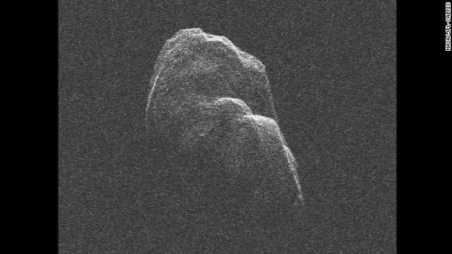 The three-mile long (4.8-kilometer) asteroid Toutatis flew about 4.3 million miles (6.9 million kilometers) from Earth on December 12, 2012. NASA scientists used radar images to <a href='http://www.youtube.com/watch?v=fo38qU00HlQ' target='_blank'>make a short movie</a>.