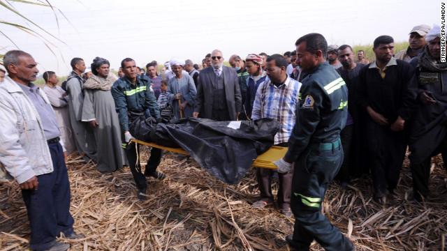 Egyptian medics carry a body on a stretcher.