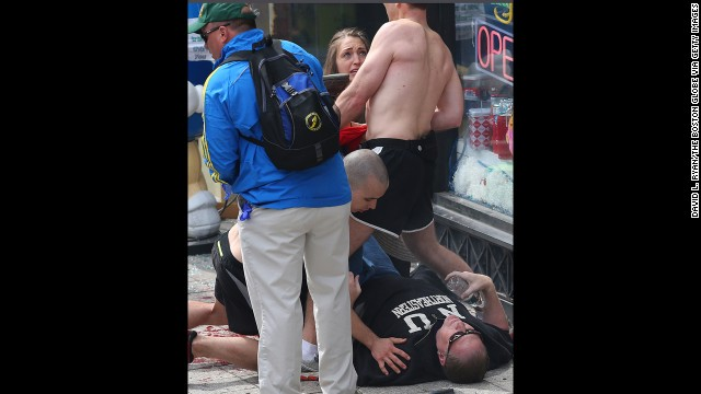 A man lays on the ground after the incident.