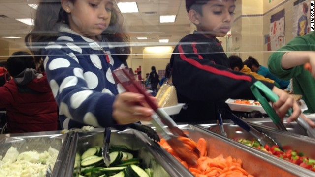Students at the Active Learning Elementary School in Queens check out the cafeteria salad bar.