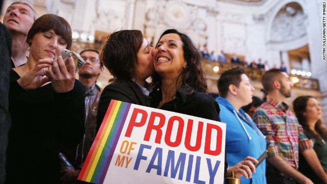 A couple celebrates at San Francisco City Hall upon hearing about the U.S. Supreme Court rulings on same-sex marriage on June 26, 2013. The high court cleared the way for same-sex couples in California to resume marrying after dismissing an appeal on Proposition 8 on jurisdictional grounds.
