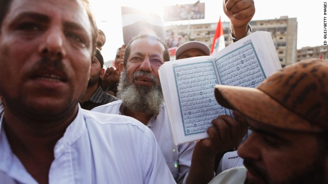A Morsy supporter holds up the Quran in Nasr City on July 8.