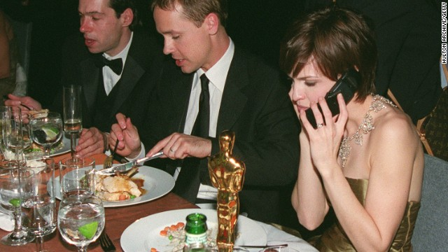 Actress Hilary Swank uses a flip phone in 2000.
