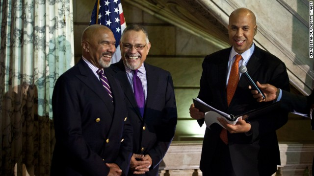 Newark, New Jersey, Mayor Cory Booker officiates a wedding ceremony for Joseph Panessidi and Orville Bell at City Hall on Monday, October 21. The state Supreme Court denied the state's request to prevent same-sex marriages temporarily, clearing the way for same-sex couples to marry.