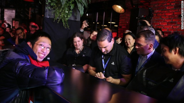 Joey Chiu, 24, of Brooklyn, left, buys the first PlayStation 4 sold in North America at a launch event presented by Sony Entertainment Network on November 14 in New York City.