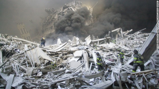Firefighters look for survivors in the rubble of the World Trade Center after the terrorist attack on September 11, 2001.
