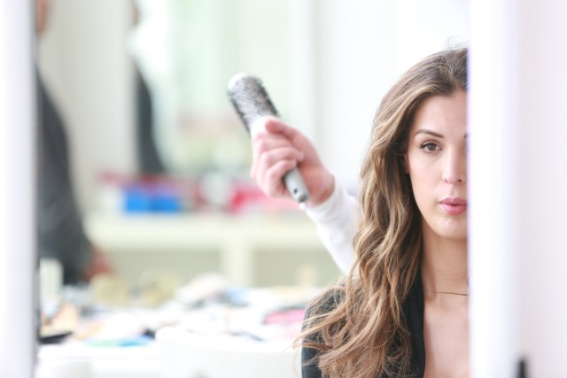 Carmen Carrera gets her hair done for a photo shoot with Glamour Magazine UK..