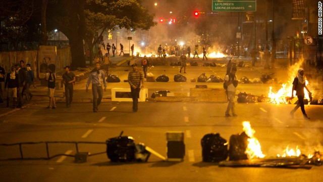 Barricades set up by opposition protesters block a road in the Altamira neighborhood of Caracas, Venezuela, on Thursday, February 20.