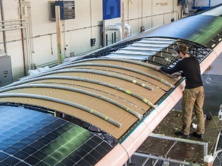 During the day, the solar cells built into the wing recharge lithium batteries, allowing the plane to fly at night.