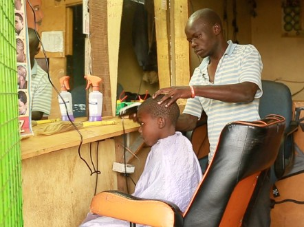 Buken Makokha inside his barbershop.