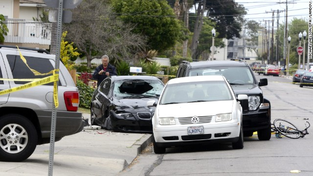 """A police officer inspects the car of the suspected gunman on Saturday, May 24, after deadly shootings in Isla Vista near the University of California, Santa Barbara. The suspect, described as mentally disturbed and possibly bent on retribution, sprayed bullets from his car Friday night, May 23, killing six people in a rampage called """"premeditated mass murder,"""" Santa Barbara County sheriff's deputies said. The shooter also died."""