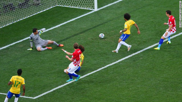 Brazil's Marcelo, second from right, accidentally deflects the ball past his own goalkeeper, Julio Cesar. It was the first goal of the tournament, and it put the host country in an early hole.