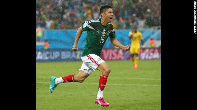 Oribe Peralta celebrates after scoring the only goal in Mexico's 1-0 win over Cameroon on June 13.