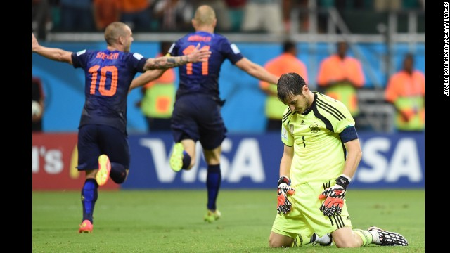 Spanish goalkeeper Iker Casillas, right, reacts after Dutch forward Arjen Robben, center, scored to put the finishing touches on a 5-1 win for the Netherlands on June 13. It was Robben's second goal of the match.