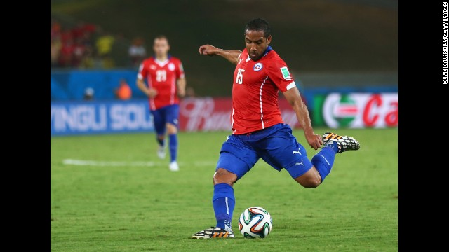 Jean Beausejour of Chile shoots and scores the final goal during the team's 3-1 win over Australia during the World Cup on Friday, June 13.