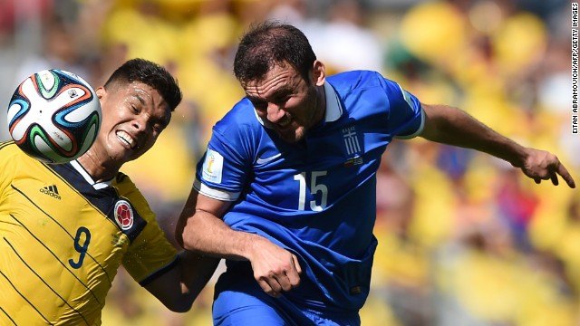 Greece's defender Vasilis Torosidis, right, vies with Colombia's forward Teofilo Gutierrez.