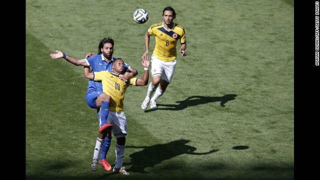 Greece's forward Georgios Samaras, left, vies with Colombia's defender Juan Camilo Zuniga, whose teammate Abel Agui watches on.
