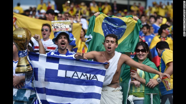 Greece fans hold up banners prior to the start of the game.