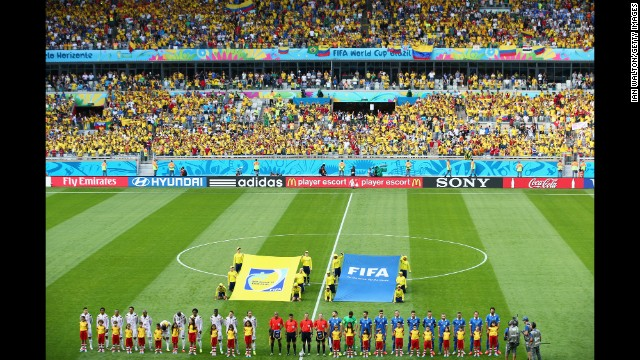 The Colombia and Greece teams line up ahead of the opening Group C match.