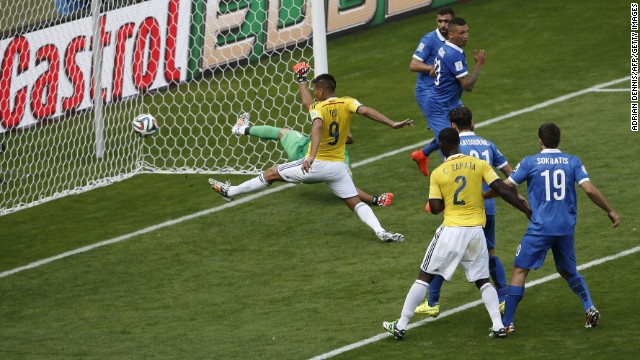 Colombia's forward Teofilo Gutierrez, center, scores during the match against Greece at the Mineirao Arena in Belo Horizonte during the 2014 FIFA World Cup on June 14.