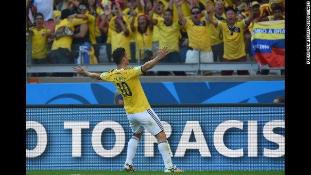 Colombia midfielder James Rodriguez celebrates after scoring his team's third and final goal during the World Cup match against Greece at the Mineirao Arena in Belo Horizonte on June 14.