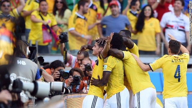 Colombia midfielder James Rodriguez, left, celebrates with teammates after scoring at Estadio Mineirao in Belo Horizonte, Brazil. Colombia defeated Greece 3-0.