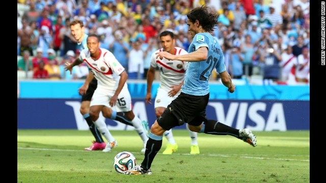 Edinson Cavani puts Uruguay ahead against Costa Rica with a first-half penalty kick in the World Cup match at Castelao on June 14.