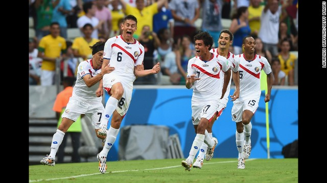 Oscar Duarte of Costa Rica, second left, celebrates scoring his team's second goal against Uruguay.