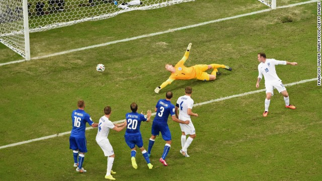 England goalkeeper Joe Hart dives in vain as Claudio Marchisio's long-range shot gives Italy the lead in the 2014 FIFA World Cup Group D match between England and Italy at Arena Amazonia in Manaus, Brazil, on June 14.