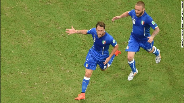 Italy midfielder Claudio Marchisio, left, celebrates with teammate Daniele De Rossi after scoring the opening goal.