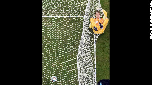 England's goalkeeper Joe Hart lies in the net after Mario Balotelli put Italy 2-1 up in the World Cup match at the Amazonia Arena in Manaus, Brazil, on June 14. Today is the third day of the soccer tournament, which is being held in 12 cities across Brazil. <a href='http://www.cnn.com/2014/06/13/football/gallery/world-cup-0613/index.html' target='_blank'>See yesterday's best photos</a>