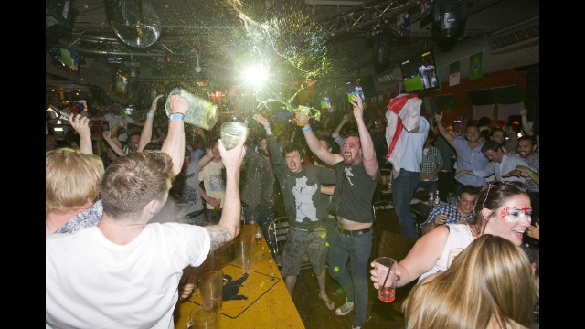 England supporters react in the Walkabout bar in central London after Sturridge's 37th-minute goal.
