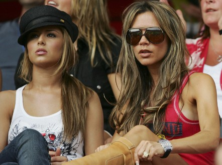 Cheryl Cole and Victoria Beckham watch the game in 2006. - (Getty Images)