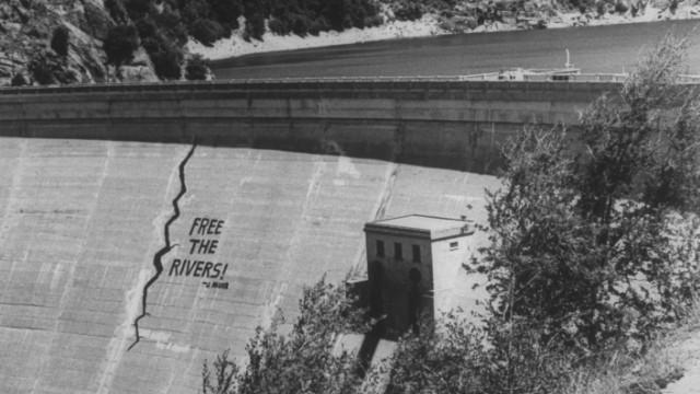 A dam with the words 'free the river' painted on it.