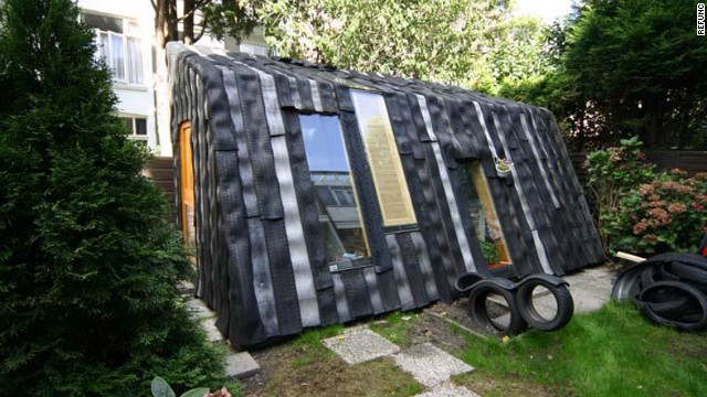 Dutch artist collective Rejunc turn wheels into walls for this garden office project.